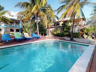 Romantic beachfront getaway with shared pool, ocean views, and topical style
