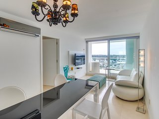 Luxury apartment with city views, shared indoor/outdoor pools, sauna