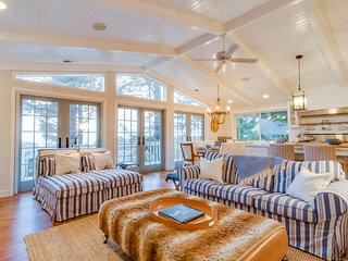 Elegant home with game room, gourmet kitchen, & deck with ocean view
